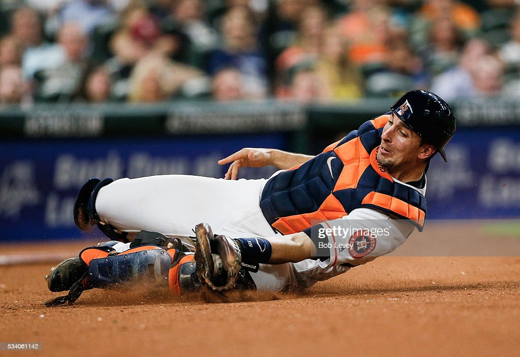 Jason Castro #15 of the Houston Astros makes a sliding catch in foul territory in the fifth inning against the Baltimore Orioles at Minute Maid Park on May 24, 2016 in Houston, Texas.
