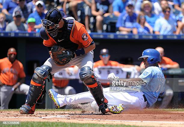 Jason Castro of the Houston Astros steps on home to get the force out on Alcides Escobar of the Kansas City Royals in the first inning at Kauffman...