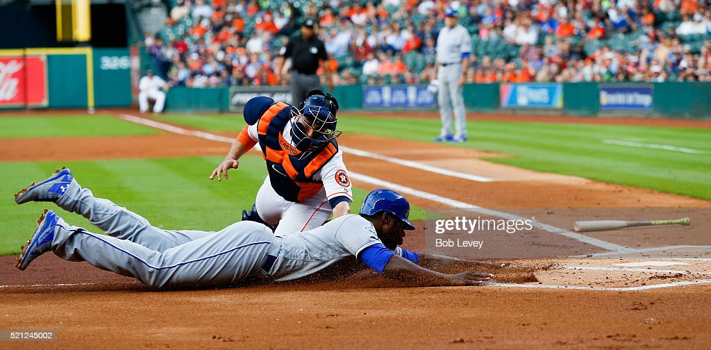 Jason Castro #15 of the Houston Astros tags out Lorenzo Cain #6 of the Kansas City Royals trying to scvore in the first inning at Minute Maid Park on April 14, 2016 in Houston, Texas.