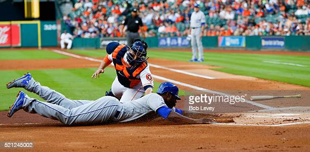 Jason Castro of the Houston Astros tags out Lorenzo Cain of the Kansas City Royals trying to scvore in the first inning at Minute Maid Park on April...