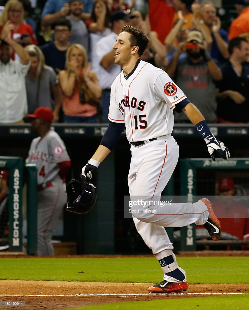 Jason Castro #15 of the Houston Astros trots home after hitting a three-run home run in the ninth inning off Fernando Salas #59 to end the game and defeat the Los Angeles Angels of Anaheim 3-0 during their game at Minute Maid Park on July 30, 2015 in Houston, Texas.