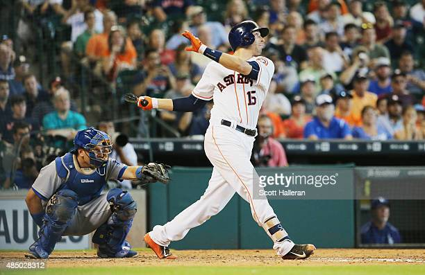Jason Castro of the Houston Astros watches his solo home run in the tenth inning to defeat the Los Angeles Dodgers 32 during their game at Minute...