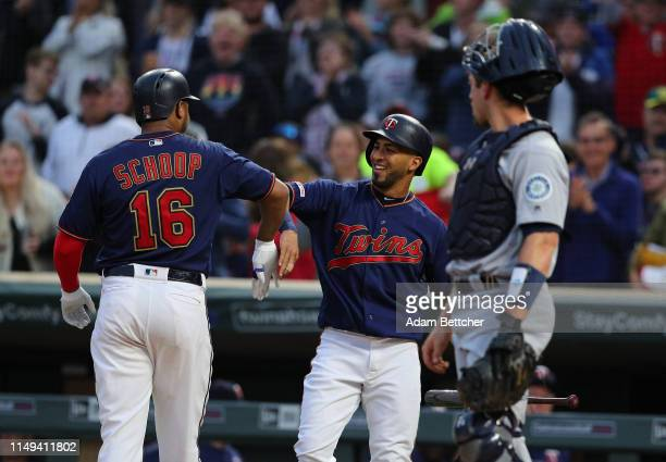 Jason Castro of the Minnesota Twins celebrates a Jonathan Schoop two run homer in the fourth inning while Tom Murphy of the Seattle Mariners looks on...