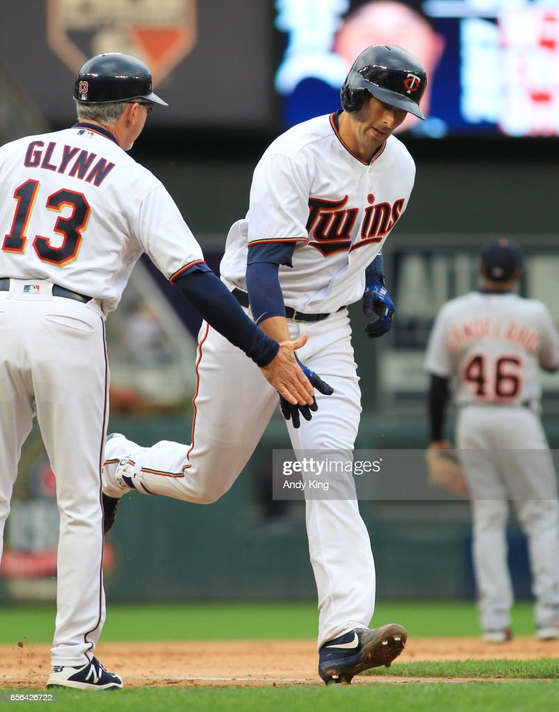 Jason Castro #21 of the Minnesota Twins is congratulated by Gene Glynn #13 of the Minnesota Twins after hitting a home run against the Detroit Tigers in the sixth inning during their baseball game on October 1, 2017, at Target Field in Minneapolis, Minnesota.