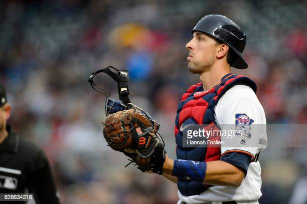 Jason Castro of the Minnesota Twins looks on while catching the game against the Texas Rangers on August 3 2017 at Target Field in Minneapolis...