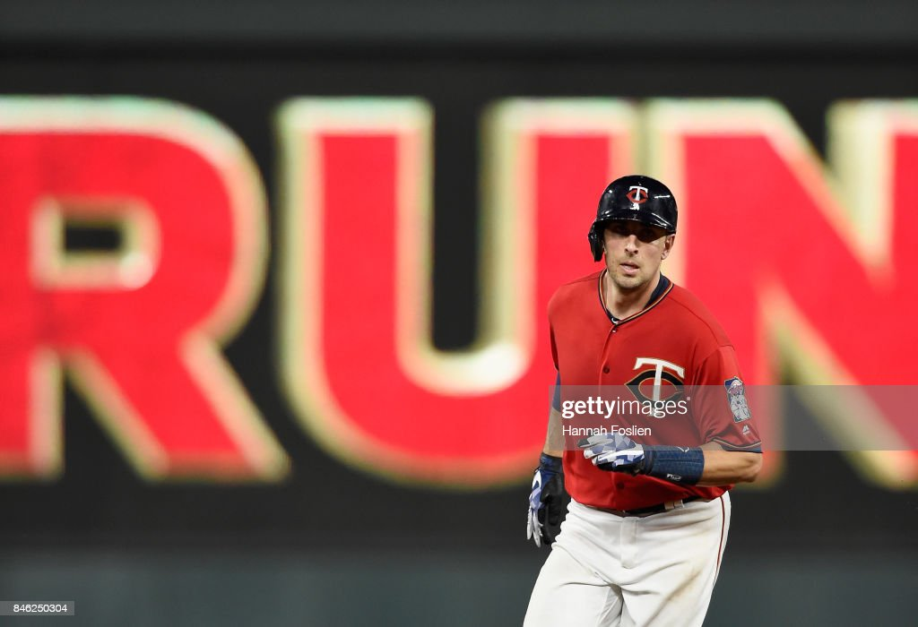 Jason Castro #21 of the Minnesota Twins rounds the bases after hitting a solo home run against the San Diego Padres during the fifth inning of the game on September 12, 2017 at Target Field in Minneapolis, Minnesota. The Twins defeated the Padres 16-0.