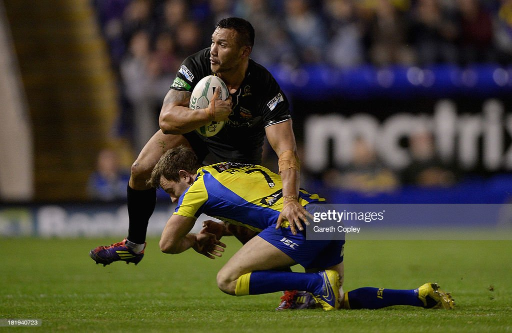 Jason Chan of Huddersfield is tackled by Richie Myler of Warrington durng the Super League Qualifying Semi Final between Warrington Wolves and Huddersfield Giants at The Halliwell Jones Stadium on September 26, 2013 in Warrington, England.