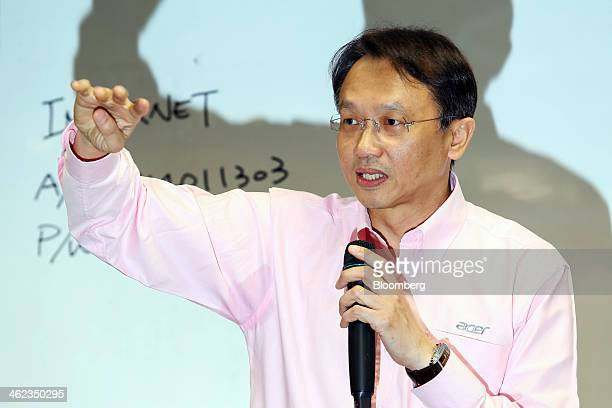 Jason Chen chief executive officer of Acer Inc gestures as he speaks during a press conference at the company's headquarters in the Hsichih district...
