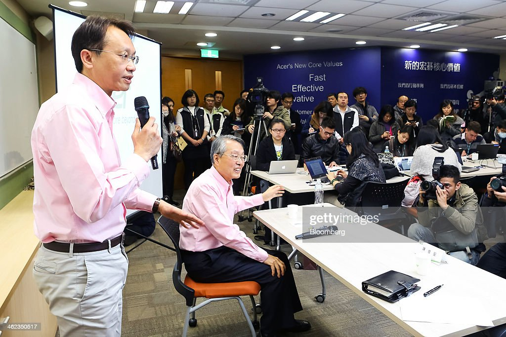 Jason Chen, chief executive officer of Acer Inc., left, speaks as Stan Shih, co-founder and chairman, looks on during a news conference at the company's headquarters in New Taipei City, Taiwan, on Monday, Jan. 13, 2014. Acers new chief executive officer plans to build on the Taiwanese personal computer makers existing hardware background to turn the company around from three years of losses. Photographer: Maurice Tsai/Bloomberg via Getty Images
