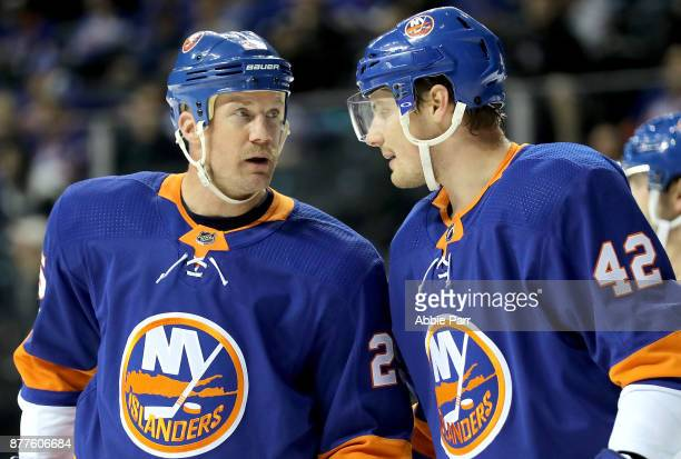 Jason Chimera and Scott Mayfield of the New York Islanders talk in the first period against the Philadelphia Flyers during their game at Barclays...