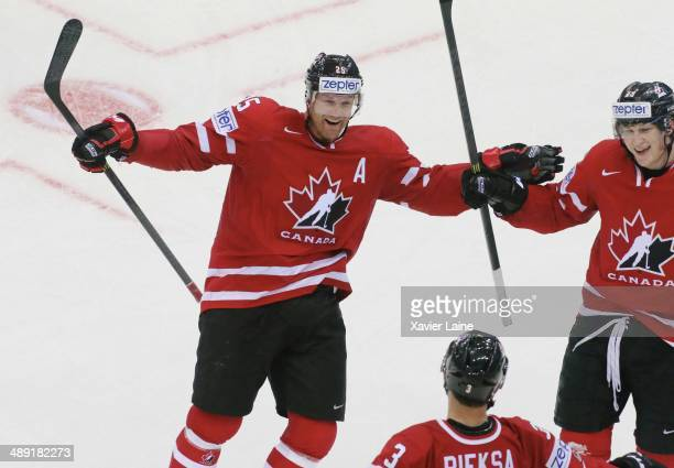 Jason Chimera Nathan Mackinnon and captain Kevin Bieksa of Canada celebrate a goal during the 2014 IIHF World Championship between Canada and...