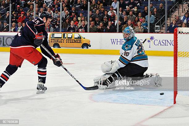 Jason Chimera of the Columbus Blue Jackets slips a shot past goaltender Evgeni Nabakov of the San Jose Sharks for the score during the first period...