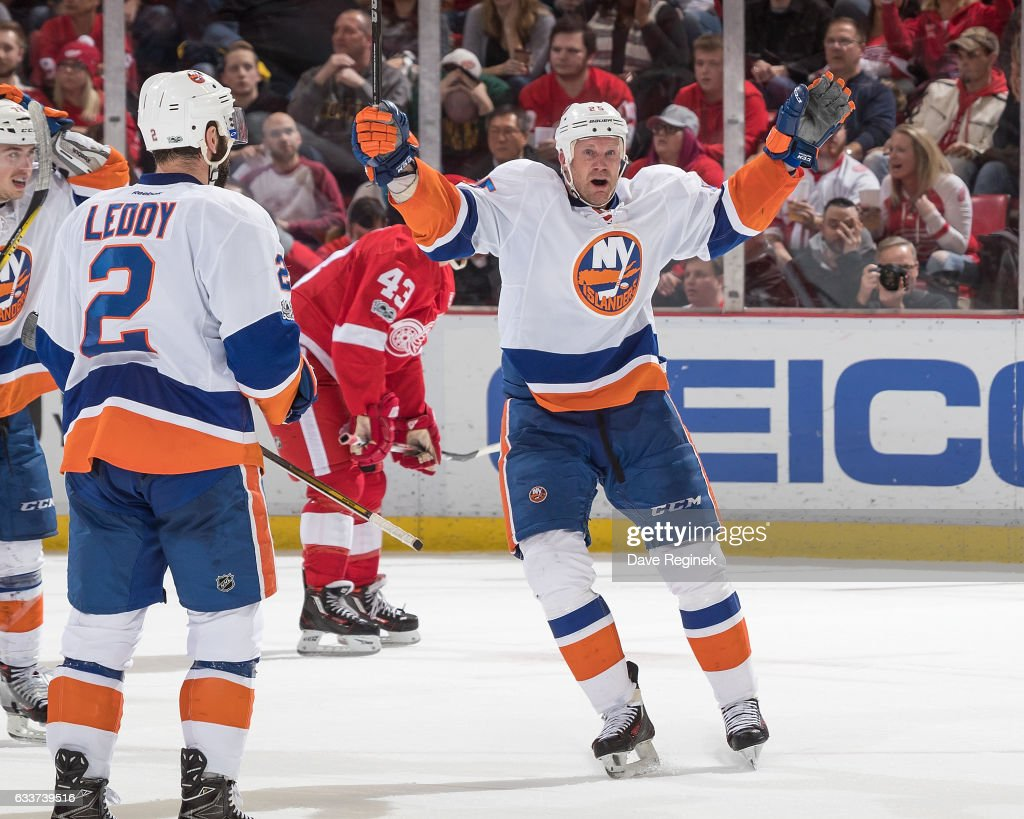 Jason Chimera #25 of the New York Islanders celebrates his third period goal with teammate Nick Leddy #2 during an NHL game against the Detroit Red Wings at Joe Louis Arena on February 3, 2017 in Detroit, Michigan. The Wings defeated the Islanders 5-4.