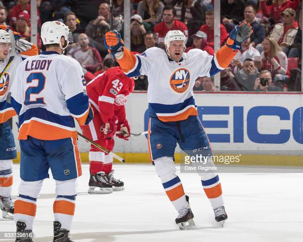 Jason Chimera of the New York Islanders celebrates his third period goal with teammate Nick Leddy during an NHL game against the Detroit Red Wings at...
