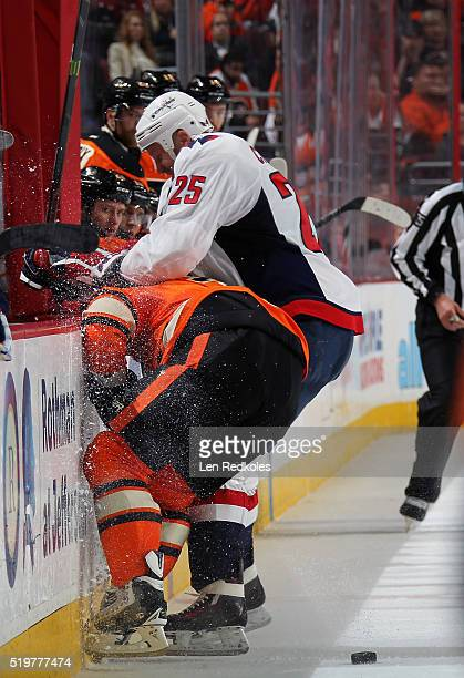 Jason Chimera of the Washington Capitals battles for the puck along the boards against Radko Gudas of the Philadelphia Flyers on March 30 2016 at the...