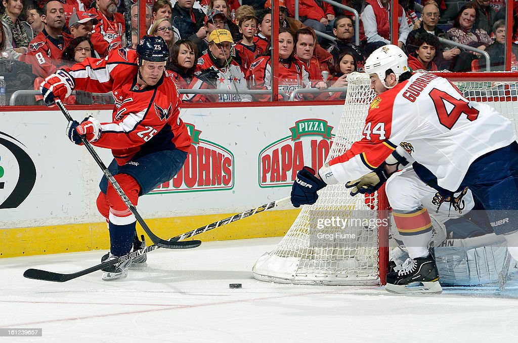 Jason Chimera #25 of the Washington Capitals brings the puck around the net against Erik Gudbranson #44 of the Florida Panthers at the Verizon Center on February 9, 2013 in Washington, DC.