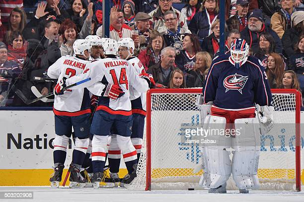 Jason Chimera of the Washington Capitals celebrates his first period goal with teammates Matt Niskanen Alex Ovechkin Justin Williams and Evgeny...