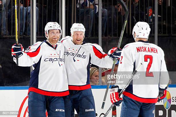 Jason Chimera of the Washington Capitals celebrates with Karl Alzner and Matt Niskanen after scoring in the third period against the New York Rangers...