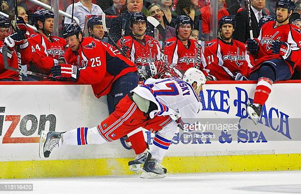 Jason Chimera of the Washington Capitals checks Brandon Dubinsky of the New York Rangers in Game Five of the Eastern Conference Quarterfinals during...