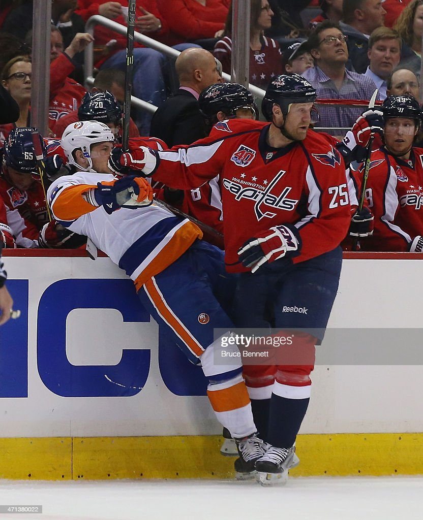 Jason Chimera #25 of the Washington Capitals hits Matt Donovan #46 of the New York Islanders during the first period in Game Seven of the Eastern Conference Quarterfinals during the 2015 NHL Stanley Cup Playoffs at Verizon Center on April 27, 2015 in Washington, DC.