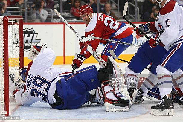 Jason Chimera of the Washington Capitals scores a goal on goalie Mike Condon of the Montreal Canadiens in the second period at Verizon Center on...