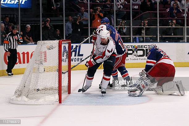 Jason Chimera of the Washington Capitals scores the gamewinning goal in the second overtime to win 43 against goalie Henrik Lundqvist of the New York...