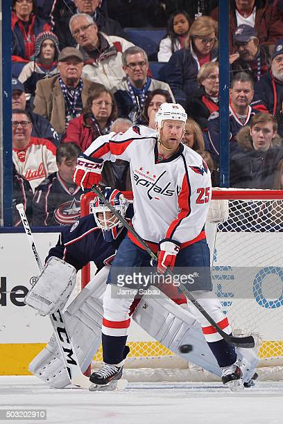 Jason Chimera of the Washington Capitals screens goaltender Curtis McElhinney of the Columbus Blue Jackets during the first period of a game on...