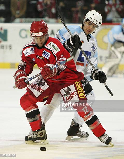 Jason Cipolla of Hanover and Jacek Plachta of Hamburg fights for the puck during the Bundesliga game between Hanover Scorpions and Hamburg Freezers...