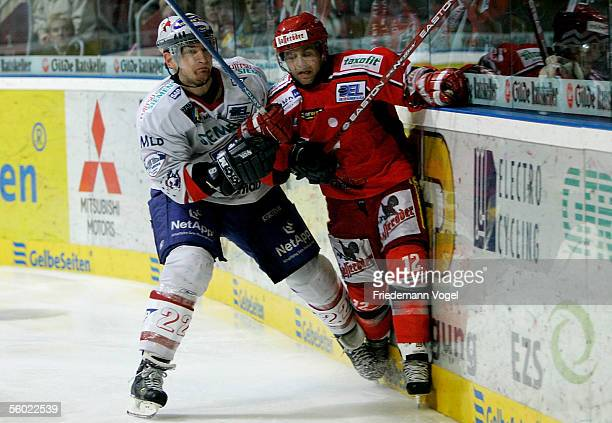 Jason Cipolla of Hanover and Michael Barkos of Mannheim fight for the puck during the DEL match between Hanover Scorpions and Adler Mannheim at the...