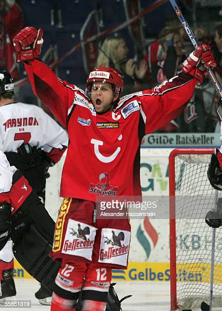 Jason Cipolla of Hanover celebrates scoring the first goal during the DEL match between Hanover Scorpions and Cologne Haie at the TUI Arena on...