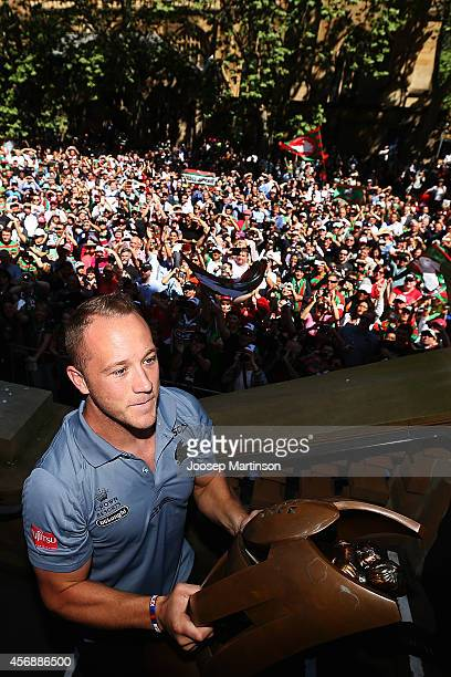 Jason Clark holds up the trophy during a South Sydney Rabbitohs NRL Grand Final celebration at Sydney Town Hall on October 9 2014 in Sydney Australia