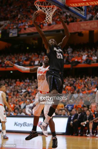 Jason Clark of the Georgetown Hoyas drives past Rick Jackson of the Syracuse Orange during the game at the Carrier Dome on February 9, 2011 in...