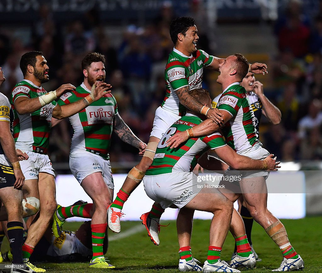 Jason Clark (r) of the Rabbitohs celebrates after scoring a try during the round 23 NRL match between the North Queensland Cowboys and the South Sydney Rabbitohs at 1300SMILES Stadium on August 13, 2015 in Townsville, Australia.