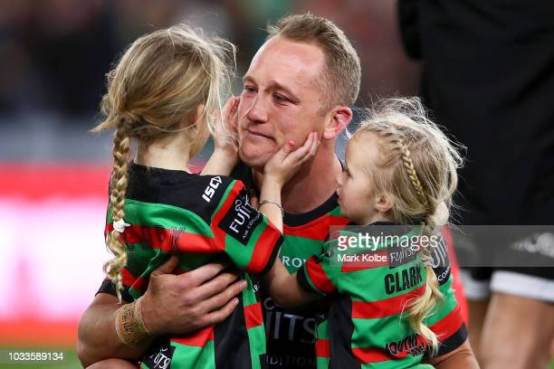 Jason Clark of the Rabbitohs celebrates victory with his daughters during the NRL Semi Final match between the South Sydney Rabbitohs and the St...