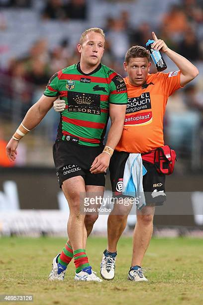 Jason Clark of the Rabbitohs is helped from the field after a head knock during the round six NRL match between the South Sydney Rabbitohs and the...