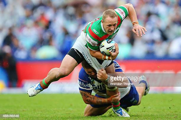 Jason Clark of the Rabbitohs is tackled by Frank Pritchard of the Bulldogs during the round five NRL match between the Canterbury Bulldogs and the...