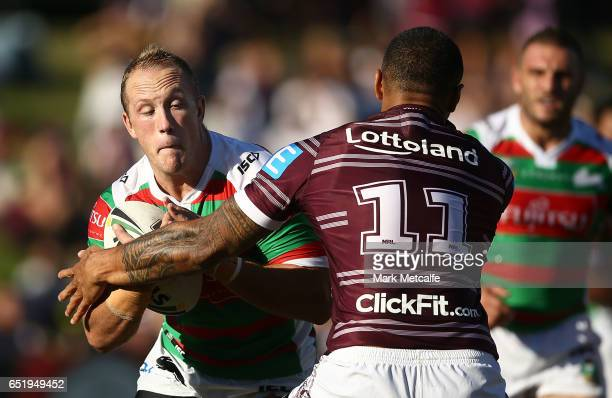 Jason Clark of the Rabbitohs is tackled by Frank Winterstein of the Sea Eagles during the round two NRL match between the Manly Sea Eagles and the...