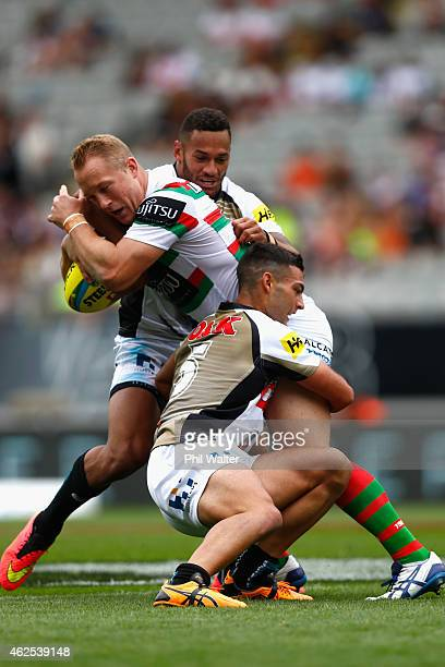 Jason Clark of the Rabbitohs is tackled during the match between the Panthers and the Rabbitohs in the 2015 Auckland Nines at Eden Park on January 31...