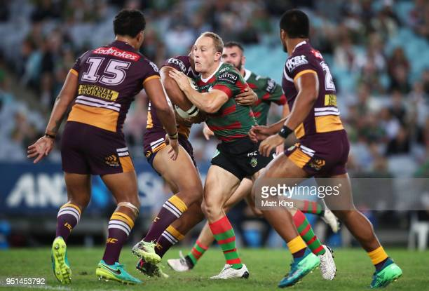 Jason Clark of the Rabbitohs is tackled during the NRL round eight match between the South Sydney Rabbitohs and the Brisbane Broncos at ANZ Stadium...