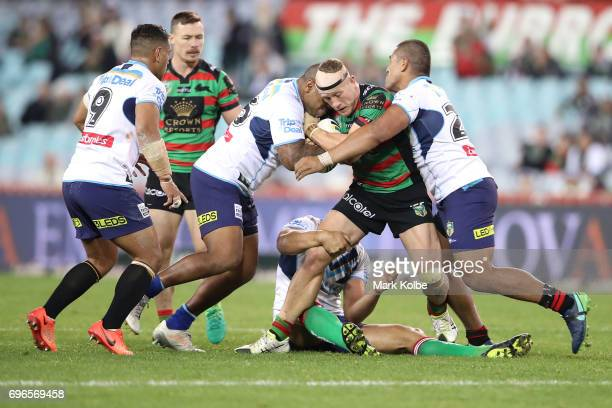 Jason Clark of the Rabbitohs is tackled during the round 15 NRL match between the South Sydney Rabbitohs and the Gold Coast Titans at ANZ Stadium on...