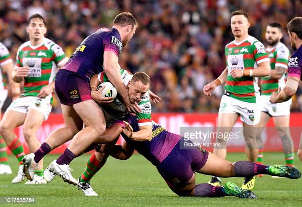 Jason Clark of the Rabbitohs is tackled during the round 23 NRL match between the Brisbane Broncos and the South Sydney Rabbitohs at Suncorp Stadium...