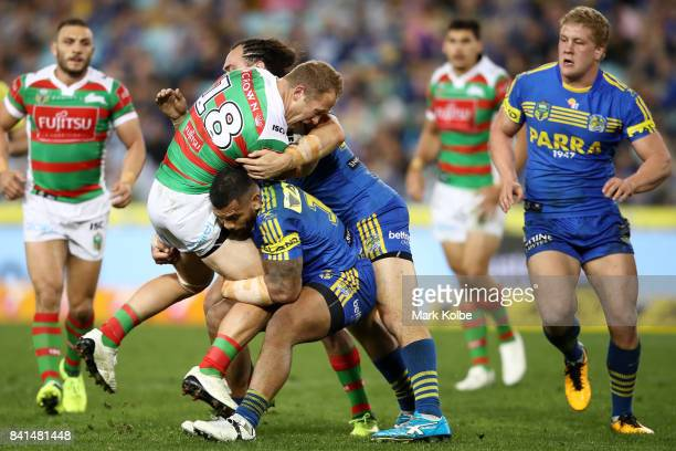 Jason Clark of the Rabbitohs is tackled during the round 26 NRL match between the Parramatta Eels and the South Sydney Rabbitohs at ANZ Stadium on...