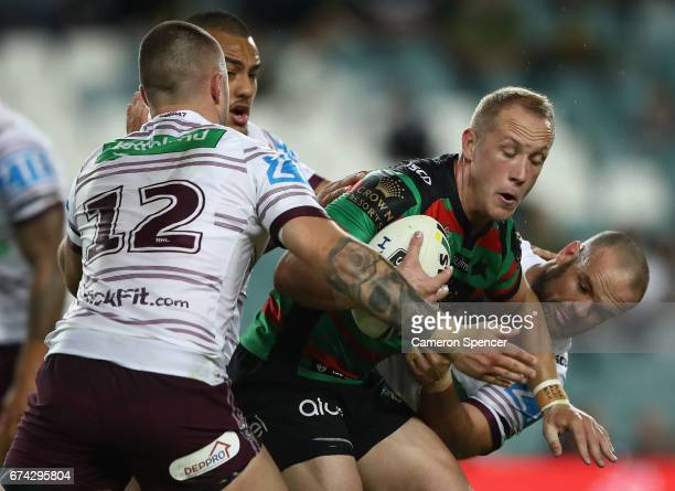 Jason Clark of the Rabbitohs is tackled during the round nine NRL match between the South Sydney Rabbitohs and the Manly Sea Eagles at Allianz...