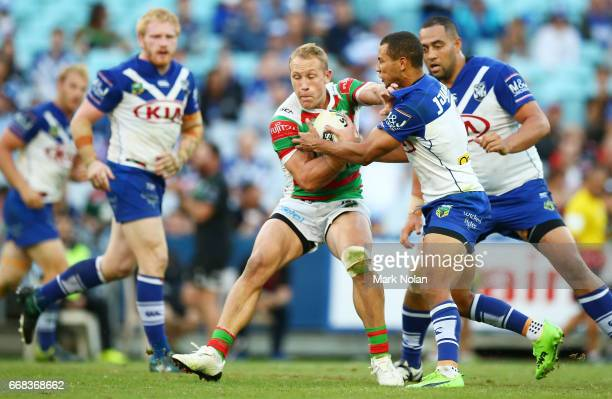 Jason Clark of the Rabbitohs is tackled during the round seven NRL match between the Canterbury Bulldogs and the South Sydney Rabbitohs at ANZ...