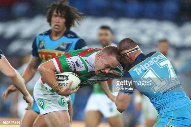 Jason Clark of the Rabbitohs runs the ball during the round 14 NRL match between the Gold Coast Titans and the South Sydney Rabbitohs at Cbus Super...