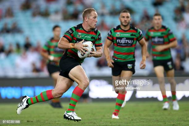 Jason Clark of the Rabbitohs runs with the ball during the NRL trial match between the South Sydney Rabbitohs and Wigan at ANZ Stadium on February 17...