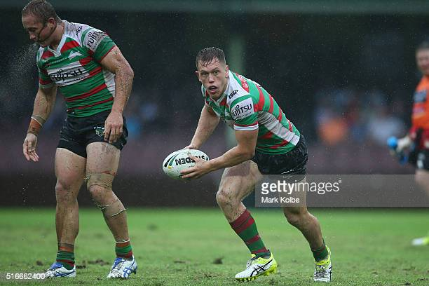 Jason Clark of the Rabbitohs spits mud and water as Cameron McInnes of the Rabbitohs looks to pass during the round three NRL match between the St...