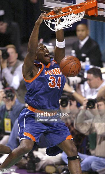 Jason Clark of the Virginia Cavaliers dunks the ball during their ACC Quarterfinal game versus the Duke Blue Devils on March 12 2004 at the...