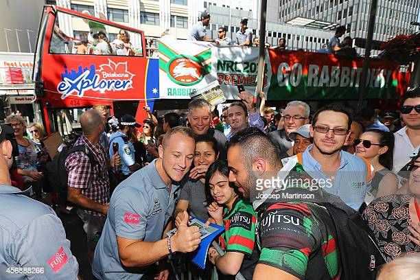 Jason Clark poses with fans during a South Sydney Rabbitohs NRL Grand Final celebration at Sydney Town Hall on October 9 2014 in Sydney Australia