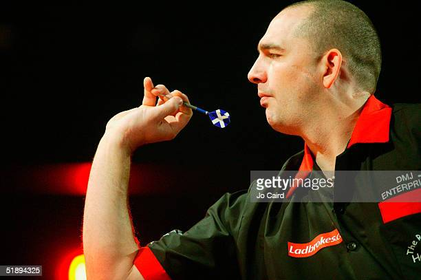 Jason Clarke of England throws during the 2005 Ladbrokescom World Darts Championship at The Circus Tavern on December 26 2004 in Purfleet England